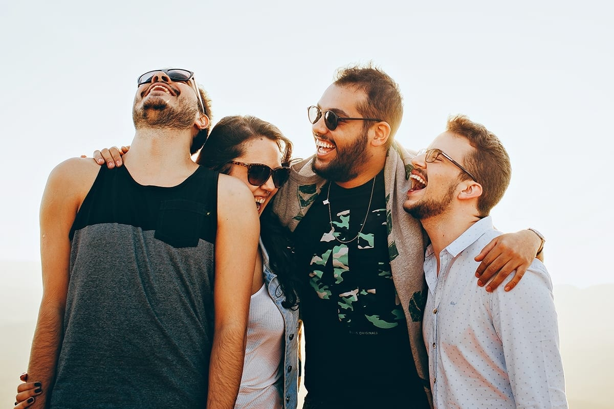 laughing group of persons in a sunset background | before clipping path service