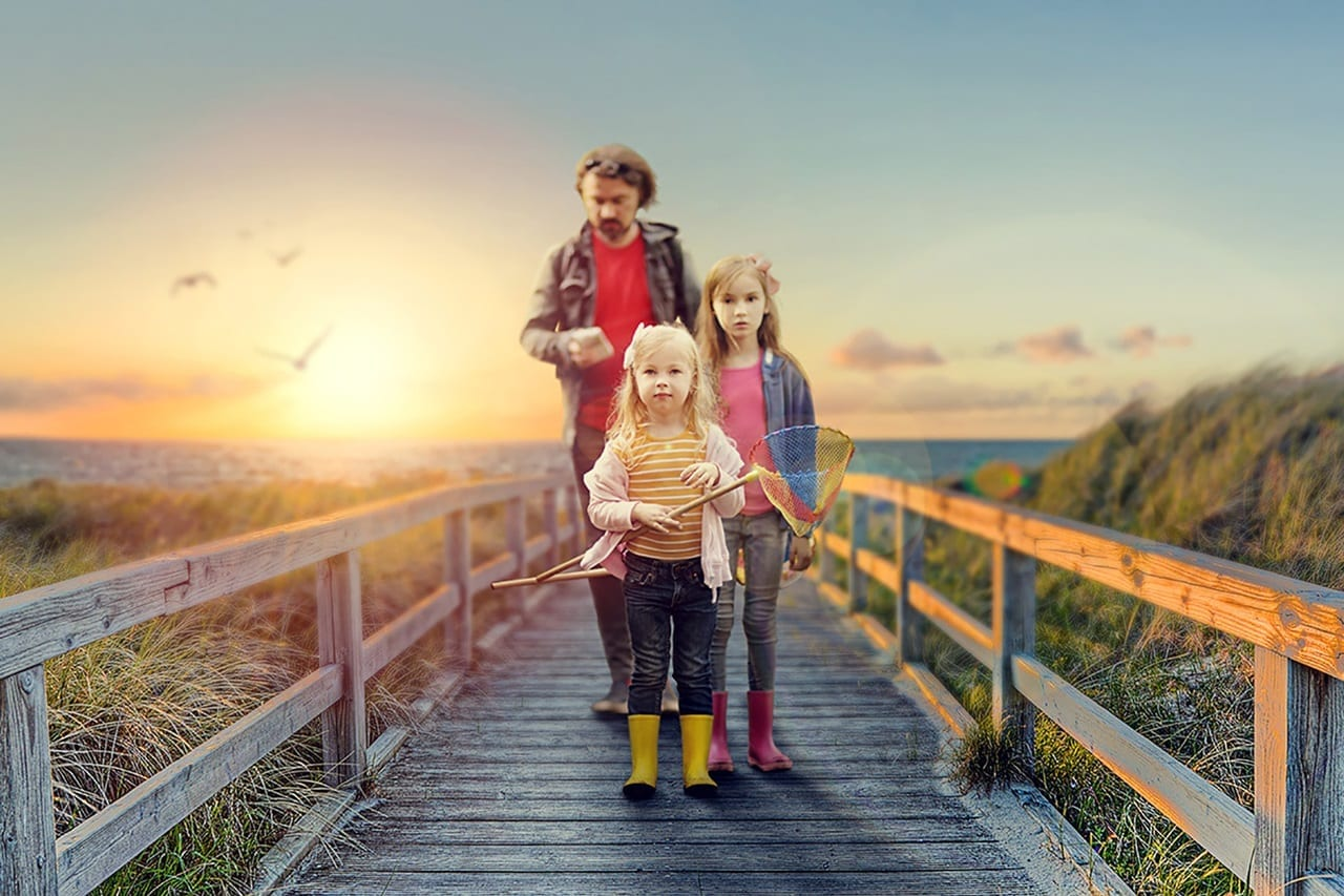 family on a wooden bridge to the ocean sunset scene | after retouching