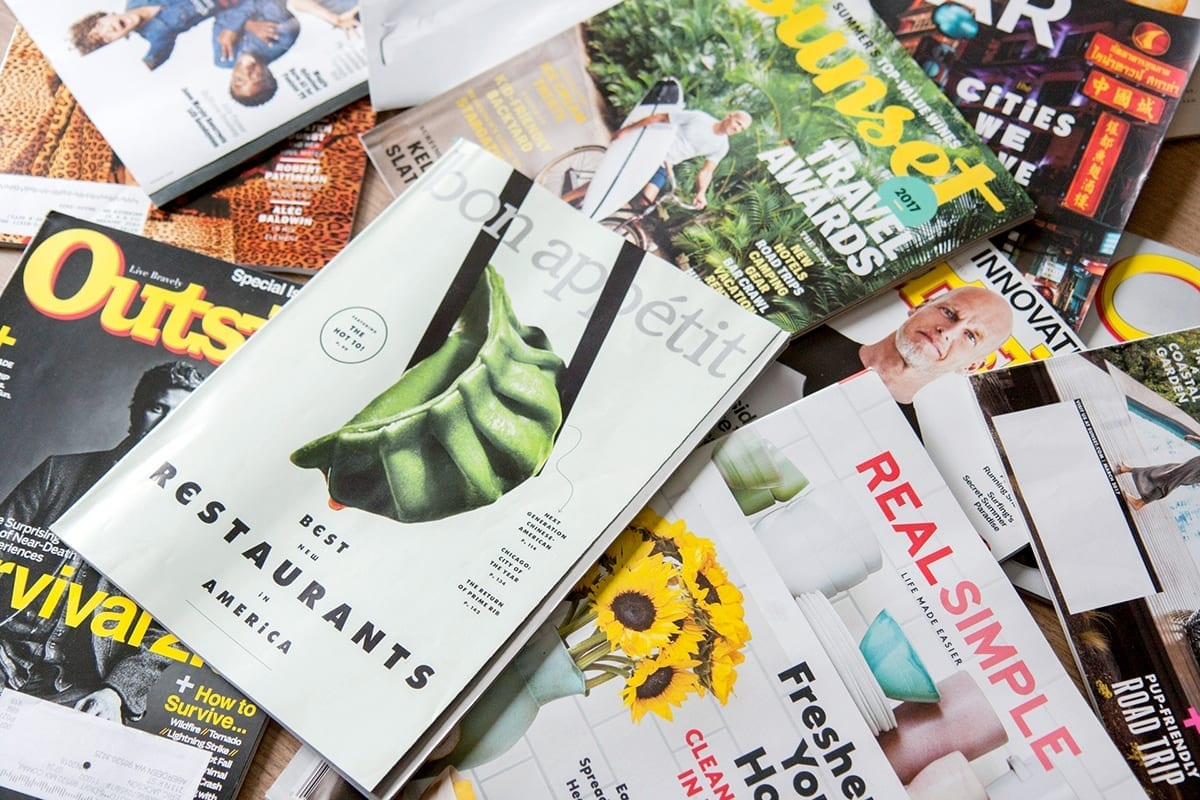 many magazines unsorted on one picture | sample of catalog & magazine production